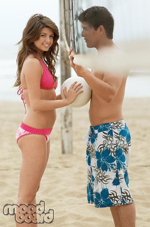 Couple Flirting on Beach