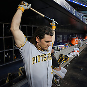 NEW YORK, NEW YORK - June 14:  John Jaso #28 of the Pittsburgh Pirates prepare to bat in the dugout during the Pittsburgh Pirates Vs New York Mets regular season MLB game at Citi Field on June 14, 2016 in New York City. (Photo by Tim Clayton/Corbis via Getty Images)