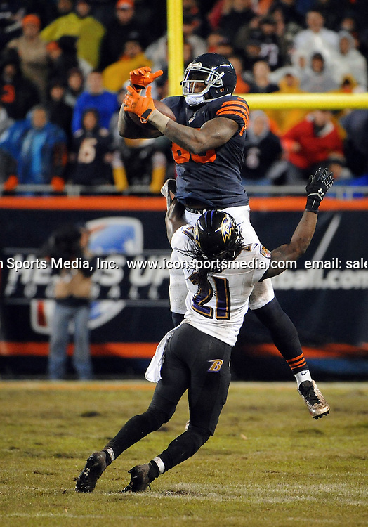 Nov. 17, 2013 - Chicago, IL, USA - Martellus Bennett, top, of the Chicago Bears catches a 43-yard pass over Lardarius Webb (21) of the Baltimore Ravens in overtime at Soldier Field in Chicago on Sunday, Nov. 17, 2013
