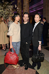 Left to right, MIMI XU, KINDER AGGUGINI and ROSEY CHAN at a VIP preview of the V&A's new exhibition 'The Glamour of Italian Fashion' - a comprehensive look at Italian Fashion from 1945-2014 held at The Victoria & Albert Museum, London on 2nd April 2014.