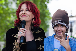 London, UK. 30 May, 2019. Dr Carrie Grant, broadcaster and SEND parent, seen here with her daughter Imogen, addresses fellow campaigners from SEND National Crisis attending a demonstration in Parliament Square to demand improvements in the diagnosis and assessment of young people with SEND, assistance for their families, funding and legal and financial accountability for local authorities in their treatment of young people with SEND and their families.