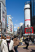 A Banner showing the height of the March 11th 2011 Tohoku tsunami over looking Shibuya's  Famous scramble crossing Tokyo, Japan. Friday March 8th 2019.  The banner, by Yahoo Japan, will be on display until March 14th and  vividly marks the 8th anniversary of the 2011 magnitude 9 earthquake and tsunami on Japan's north-east coast that killed nearly 16,000 people .The red line marks the heightest tsunami wave at 16.7 metres, which hit Ofunato, Iwate on that day.