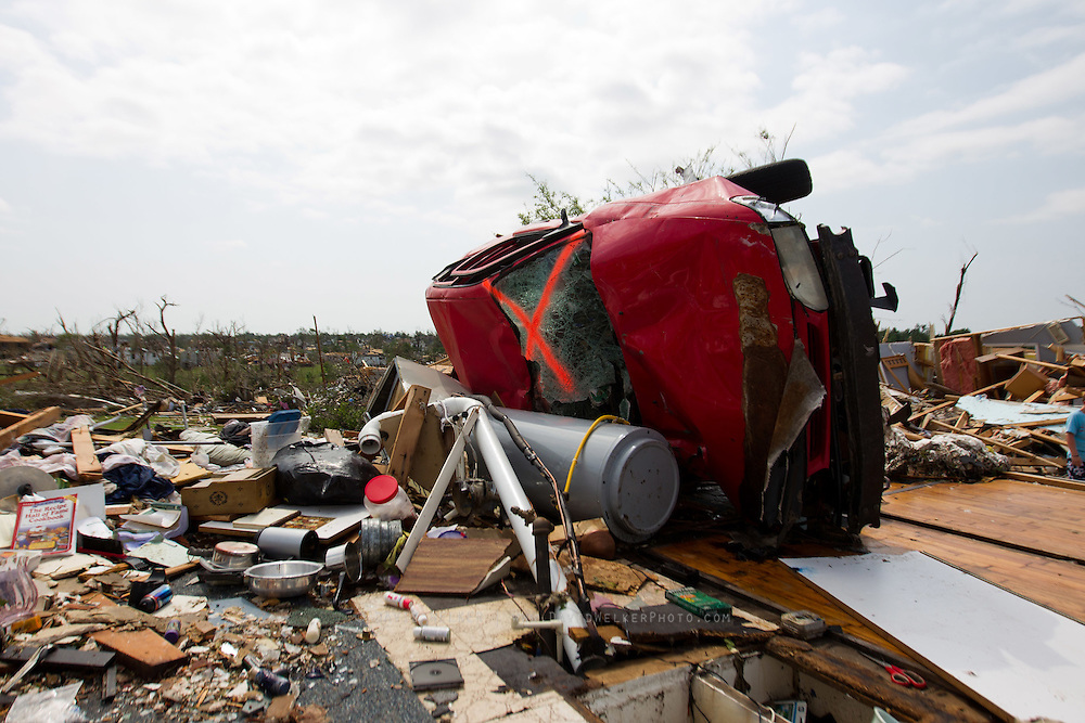 May 24, 2011- A car sits on the remains of the first floor of a home in Joplin, Missouri after a Tornado came through the town on Sunday, May 22, 2011. The storm left over 100 people dead and more than 1,000 missing. Credit: David Welker / TurfImages.com