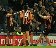 Ahmed Elmohamady (left) of Hull City celebrates his goal with his team mates to make it 1-0 during the Barclays Premier League match at KC Stadium, Hull<br /> Picture by Richard Gould/Focus Images Ltd +44 7855 403186<br /> 01/01/2015