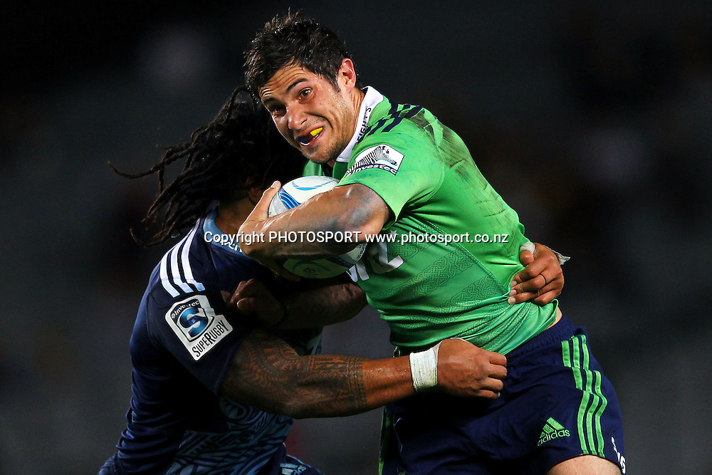 Phil Burleigh of the Highlanders fends against Ma'a Nonu of the Blues. Super Rugby rugby union match, Blues v Highlanders at Eden Park, Auckland, New Zealand. Saturday 29th March 2014. Photo: Anthony Au-Yeung / photosport.co.nz