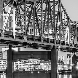 Peoria Illinois panoramic black and white picture of Murray Baker Bridge at night. The Murray Baker Bridge spans the Illinois River connecting Peoria with East Peoria as Interstate I-74. Built in 1958, the bridge is named after Murray Baker who started a company that would later become Caterpillar. Panorama photo ratio is 1:3.
