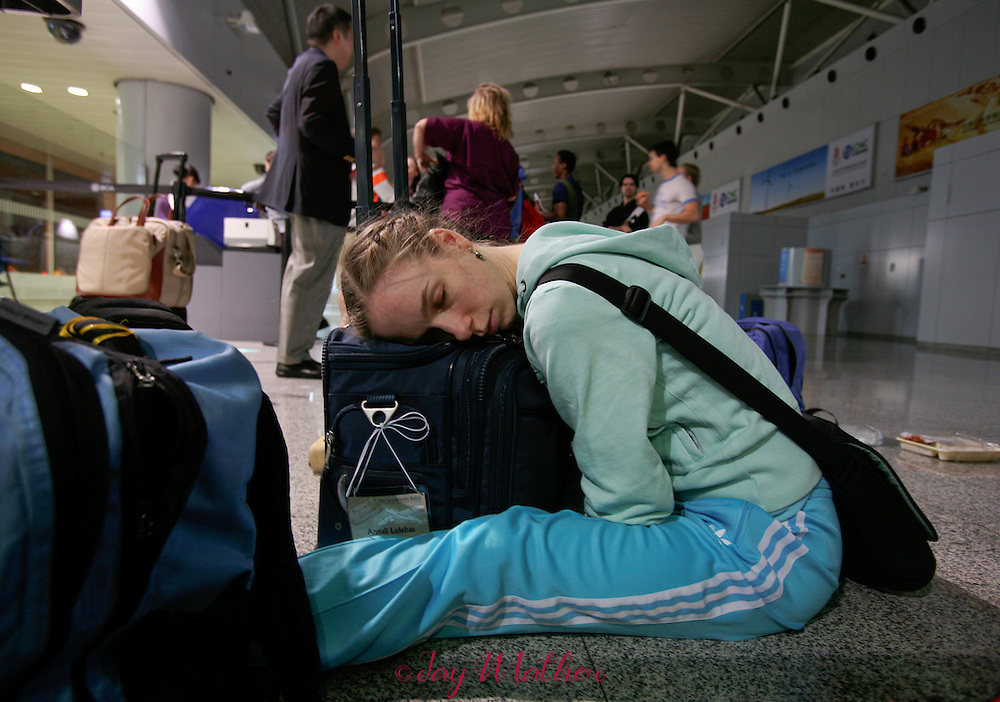 Annali Lulebas tries to rest during a layover in Beijing as The Sacramento Ballet Company began it's two-week tour to the People's Republic of China, Tuesday, May 1, 2007.