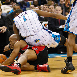 January 17, 2011; New Orleans, LA, USA; Toronto Raptors guard Sundiata Gaines (2) and New Orleans Hornets small forward Trevor Ariza (1) scramble for a loose ball during the fourth quarter at the New Orleans Arena. The Hornets defeated the Raptors 85-81.  Mandatory Credit: Derick E. Hingle