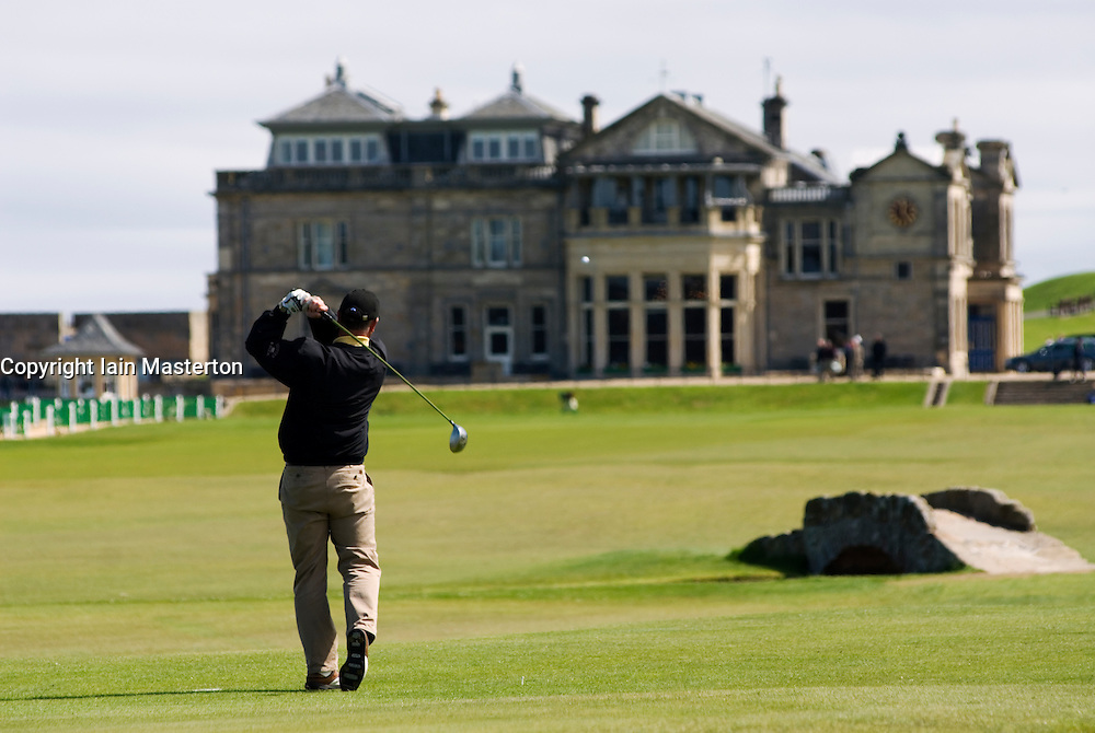 Golfer drives from Tee  on 18th hole at Old Course in St Andrews Scotland