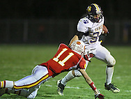 Central DeWitt's Jacob Feldpausch (34) tries to avoid a diving tackle by Marion's Quinn Cannoy (11) during their second round playoff football game at Thomas Park Field in Marion on Monday, October 29, 2012.