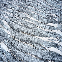 The Aletsch Glacier (German: Aletschgletscher) or Great Aletsch Glacier (German: Grosser Aletschgletscher) is the largest glacier in the Alps. It has a length of about 23 km (14 mi) and covers more than 120 square kilometres (46 sq mi) in the eastern Bernese Alps in the Swiss canton of Valais. The Aletsch Glacier is composed of three smaller glaciers converging at Concordia, where its thickness is estimated to be near 1 km (3,300 ft). It then continues towards the Rhone valley before giving birth to the Massa River.<br /> <br /> The whole area, including other glaciers is part of the Jungfrau-Aletsch Protected Area, which was declared a UNESCO World Heritage site in 2001. Aletsch Glacier in the Swiss Alps<br /> Photographed by Jürg Kaufmann<br /> <br /> The Swiss Alps Jungfrau-Aletsch region was inscribed on the UNESCO list in 2001. This wonderful mountain area with its unspoiled landscape, imposing peaks and magnificent glacier more than met all of the criteria imposed by the UNESCO World Heritage Committee.