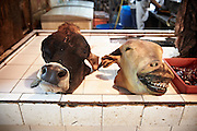 Cow heads for sale in the Kuala Lumpur Wet Market. Malaysia. 24th November 2012.