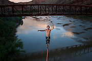 Sylvan Christensen walks a bridge line over the Colorado River.<br />