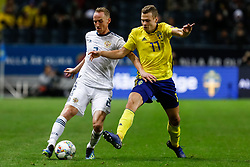November 21, 2018 - Stockholm, Sweden - Viktor Claesson (R) of Sweden and Vladislav Ignatyev of Russia vie for the ball during the UEFA Nations League B Group 2 match between Sweden and Russia on November 20, 2018 at Friends Arena in Stockholm, Sweden. (Credit Image: © Mike Kireev/NurPhoto via ZUMA Press)