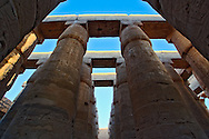 Skyward view of massive columns at the Great Hypostyle Hall, in the temple of Amun, The Temple of Karnak in modern day Luxor or ancient Thebes.  Widely considered the largest temple complex every built by man.