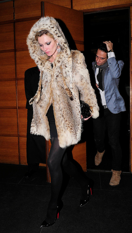 17.NOV.2009.  LONDON<br /> <br /> SUPERMODEL KATE MOSS WHO IS WEARING A FUR COAT AND BOYFRIEND JAMIE HINCE LEAVE A FRIENDS HOUSE IN MAYFAIR AT 2.30AM AND HEADED ONTO ALMADA NIGHTCLUB IN MAYFAIR. KATE AND JAMIE LEFT THE CLUB AT 5.00AM AND KATE PUT HER HOOD UP ON HER JACKET TO PRTECT HER FROM THE WIND<br /> <br /> BYLINE: EDBIMAGEARCHIVE.COM<br /> <br /> *THIS IMAGE IS STRICTLY FOR UK NEWSPAPERS & MAGAZINES ONLY*<br /> *FOR WORLDWIDE SALES & WEB USE PLEASE CONTACT EDBIMAGEARCHIVE-0208 954 5968*