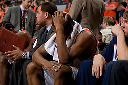 Virginia guard Jeff Jones (1) holds his head on the bench as the Virginia Cavaliers men's basketball team fell the Clemson Tigers at 82-51 the John Paul Jones Arena in Charlottesville, VA on February 7, 2008.