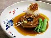 "China, Sichuan. Chengdu. Yu Zhi Lan gourmet restaurant. ""The essential taste of superior abalone"""