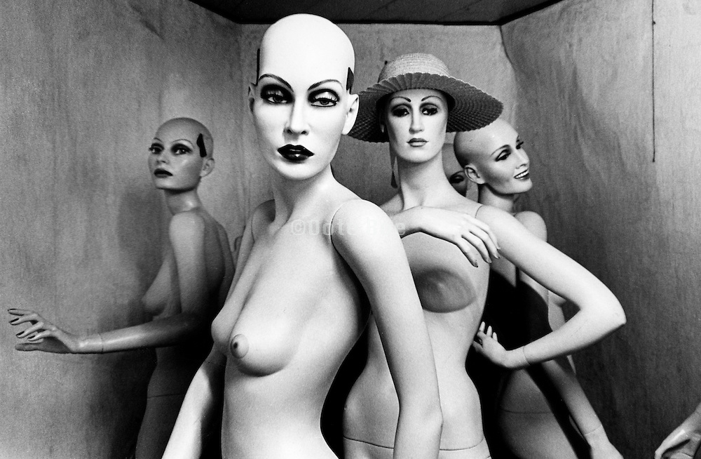 Four mannequins in a small room