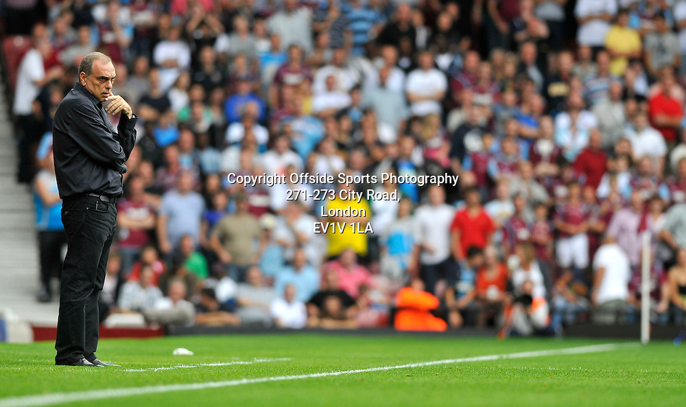 21/08/2010 - Premiership Football - West Ham United vs Bolton Wanderers - Avram Grant watches over the game. - Photo: Charlie Crowhurst / Offside.