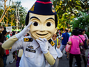 24 NOVEMBER 2018 - BANGKOK, THAILAND:  A Thai Air Force mascot salutes Red Cross Fair attendees. The Red Cross Fair is a fund raiser and an annual event in Bangkok that draws thousands of attendees every night of its nine day run. This is the first year the fair has been in Lumpini Park. Previously it had been held in the Dusit section of Bangkok. The 2018 Fair marks 125 years of service for the Red Cross in Thailand.    PHOTO BY JACK KURTZ
