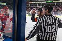 KELOWNA, BC - JANUARY 31: Line official Dustin Minty stands at the boards as referee Chris Crich recalls a Spokane Chiefs' player to the ice against the Kelowna Rockets at Prospera Place on January 31, 2020 in Kelowna, Canada. (Photo by Marissa Baecker/Shoot the Breeze)
