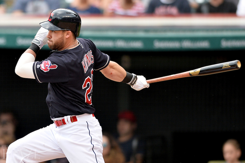 Jul 31, 2016; Cleveland, OH, USA; Cleveland Indians second baseman Jason Kipnis (22) hits an RBI single during the third inning against the Oakland Athletics at Progressive Field. Mandatory Credit: Ken Blaze-USA TODAY Sports