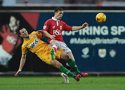 Yeovil Town's James Berrett tackles Bristol City's Todd Kane  - Photo mandatory by-line: Joe Meredith/JMP - Mobile: 07966 386802 - 26/12/2014 - SPORT - football - Bristol - Ashton Gate - Bristol City v Yeovil Town - Sky Bet League One