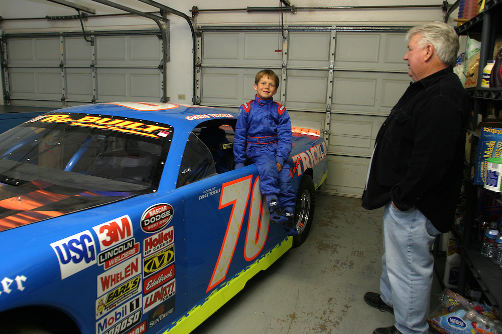 Chris Trickle 6 and his grandfather Chuck Trickle 52 ..At there garage in there home in Las Vegas Nevada looking at the NASCAR car of Christopher Trickle that hi named after. Thursday March 1.2007........Christopher Trickle got killed in Las Vegas. ..The dream of Chris Trickle junior is to drive this Nascar car that was that belongs to his uncle that he name after and got killed in Las Vegas....