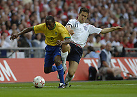 Photo: Richard Lane.<br />England v Brazil. International Friendly. 01/06/2007. <br />Brazil's Mineiro is challenged by England's Joe Cole.