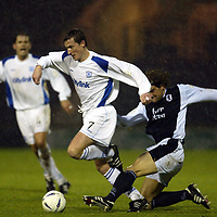 Raith Rovers v St Johnstone...29.11.03<br />Chris Hay is brought down by Matthias Jack<br /><br />Picture by Graeme Hart.<br />Copyright Perthshire Picture Agency<br />Tel: 01738 623350  Mobile: 07990 594431