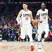23 December 2016: LA Clippers guard Austin Rivers (25) brings the ball up court next to LA Clippers forward Luc Mbah a Moute (12) during the Dallas Mavericks 90-88 victory over the LA Clippers, at the Staples Center, Los Angeles, California, USA.