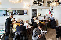 """ROME, ITALY - 7 January 2014: The interior of Bar Necci at lunch time, an airy bar and restaurant that was made famous by the Italian director Pier Paolo Pasolini who shot parts of his 1961 film """"Accattone"""" in the Pigneto neighborhood of Rome, Italy, on February 7th 2014."""