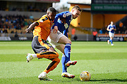 Ipswich Town striker Freddie Sears holds off Wolverhampton Wanderers defender Dominic Iorfa   during the Sky Bet Championship match between Wolverhampton Wanderers and Ipswich Town at Molineux, Wolverhampton, England on 2 April 2016. Photo by Alan Franklin.