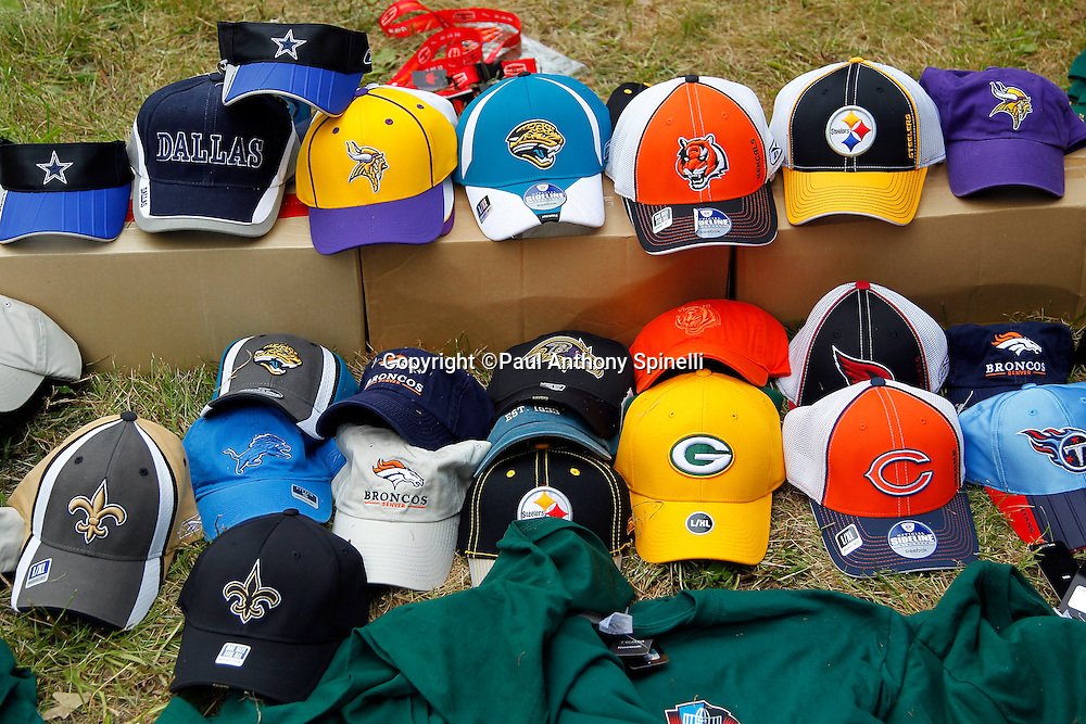 Hats from a number of NFL teams lie on the ground ready for sale prior to the Pro Football Hall of Fame preseason football game between the Dallas Cowboys and the Cincinnati Bengals on Sunday, August 8, 2010 in Canton, Ohio. The Cowboys won the game 16-7. (©Paul Anthony Spinelli)