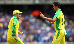 Australia's Mitchell Starc (right) and Aaron Finch during the ICC Cricket World Cup group stage match at The Oval, London.