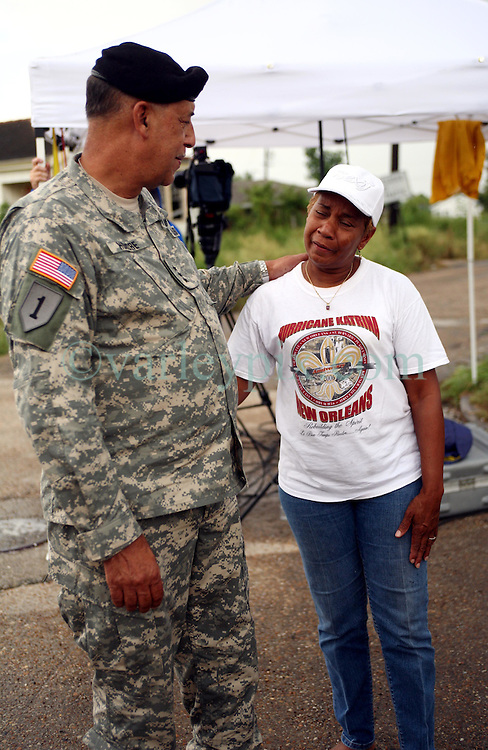 29 August  2007. Lower 9th Ward, New Orleans, Louisiana. <br /> Lieutenant General Russel L. Honore, the army commander who came to New Orleans and took charge during the darkest days following the devastation of Hurricane Katrina tries to answer questions from tearful former resident Valeria Schexnayder. Honore revisits the mainly deserted, still decimated Lower 9th Ward on the Second anniversary of Hurricane Katrina. The area remains mostly abandoned and overgrown with grass growing in the streets. President Bush came to town and claimed he could be proud of what local and federal government have achieved in the city. Yet two years after the storm, it is quite clear that local and federal government are failing and have a great deal to do to live up their promises.<br /> Photo credit&copy;; Charlie Varley/varleypix.com