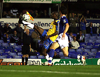 Photo: Mark Stephenson.<br /> Birmingham City v Hereford United. Carling Cup. 28/08/2007.Hereford's Theo Robinson wins the ball