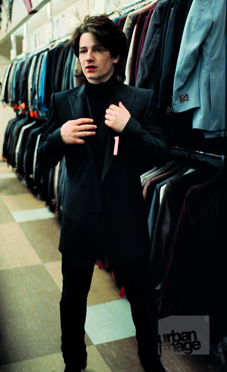 Photograph of U2 Bono on USA tour day off, buying a new jacket - 1981 Chicago  USA