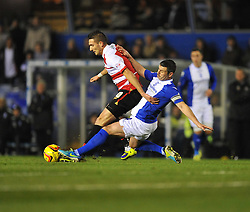 Birmingham City's Paul Robinson tackles Doncaster Rovers' Federico Macheda - Photo mandatory by-line: Alex James/JMP - Tel: Mobile: 07966 386802 03/12/2013 - SPORT - Football - Birmingham - St Andrews - Birmingham City v Doncaster Rovers - Sky Bet Championship