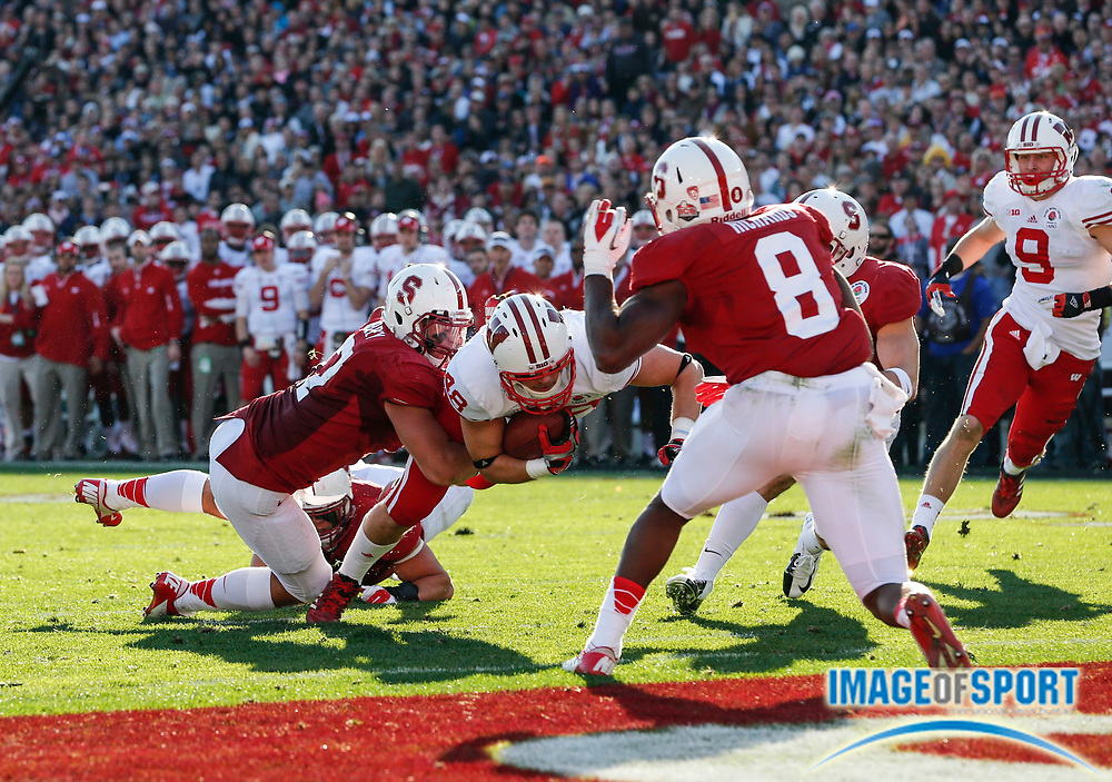 Jan 1, 2013; Pasadena, CA, USA; Wisconsin Badgers tight end Jacob Pedersen (48) takes a 9-yard reception to the  Stanford Cardinal 1-yard line where he is tackled by A.J. Tarpley (17) in the Rose Bowl. Stanford defeated Wisconsin 20-14.