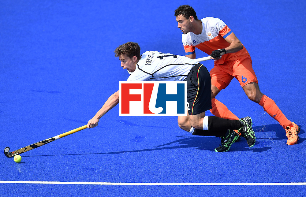 Netherlands' Jeroen Hertzberger (L) vies with Netherlands' Glenn Schuurman during the men's Bronze medal field hockey Netherlands vs Germany match of the Rio 2016 Olympics Games at the Olympic Hockey Centre in Rio de Janeiro on August 18, 2016. / AFP / MANAN VATSYAYANA        (Photo credit should read MANAN VATSYAYANA/AFP/Getty Images)