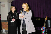 Grammy award winner Melissa Etheridge is presented with The Excellence in the Performing Arts award from the National Museum of Women in the Arts (NMWA) in Washington DC. Sunday Nov. 4, 2012. Etheridge also performed on the piano and then an acoustic set on guitar for an intimate audience of about 400 people. Photo &copy;Suzi Altman/For NMWA Grammy award winner Melissa Etheridge is presented with the National Museum of Women in the Arts&acirc;&euro;&trade; (NMWA) Award for Excellence in the Performing Arts in Washington DC. Sunday Nov. 4, 2012. Etheridge also performed on the piano and then an acoustic set on guitar for an intimate audience of about 300 people. Photo &Acirc;&copy;Suzi Altman/For NMWA<br /> <br /> Melissa Etheridge NMWA Award for Excellence in the Performing Arts