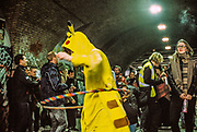 Person dressed as Pikachu hula-hooping at Freedom to Party Protest, Shoreditch, London, January 2016