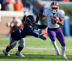 Clemson wide receiver Jacoby Ford (6) rushes past Virginia safety Byron Glaspy (22).  The Clemson Tigers defeated the Virginia Cavaliers 13-3 in NCAA Division 1 football at Scott Stadium on the Grounds of the University of Virginia in Charlottesville, VA on November 22, 2008.