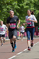 Seb Coe and Jo Pavey running together during The Vitality Westminster Mile, Sunday 28th May 2017.<br />