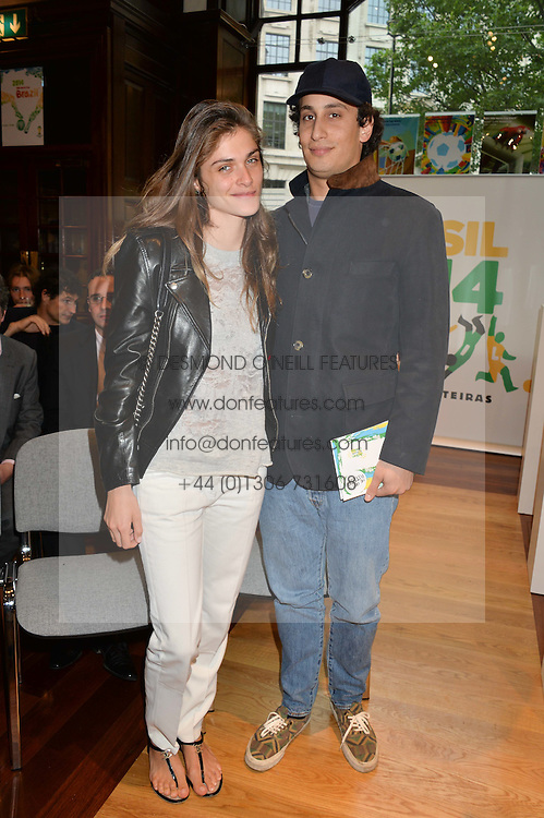 ALEX DELLAL and ELISA SEDNAOUI at the Art of Futebol - a charity auction of 11 footballs signed by 11 Brazilian legends from Pele to Neymar & decorated and designed by 11 leading contemporary artists in aid of Action for Brazil's Children Trust held at the Brazilian Embassy, 16 Cockspur Street, London on 10th July 2014.