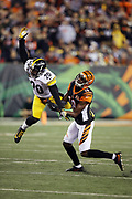 Cincinnati Bengals wide receiver A.J. Green (18) tries to catch a second quarter pass broken up by leaping Pittsburgh Steelers free safety Robert Golden (20) on a third down play during the 2017 NFL week 13 regular season football game against the Pittsburgh Steelers, Monday, Dec. 4, 2017 in Cincinnati. The Steelers won the game 23-20. (©Paul Anthony Spinelli)