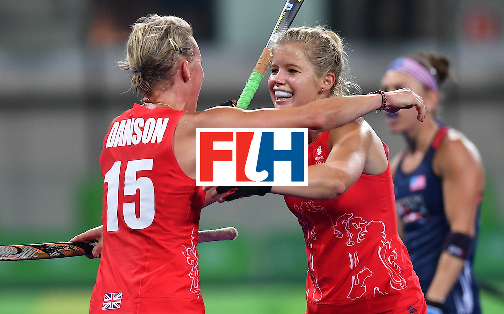 Britain's Alex Danson celebrates scoring a goal with Britain's Susannah Townsend during the women's field hockey Britain vs the USA match of the Rio 2016 Olympics Games at the Olympic Hockey Centre in Rio de Janeiro on August, 13 2016. / AFP / MANAN VATSYAYANA        (Photo credit should read MANAN VATSYAYANA/AFP/Getty Images)