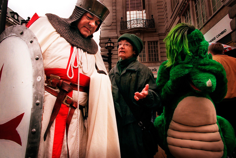 St Georges Day April 1999.Patron Saint St George and Dragon meeting people in .Piccadilly Circus London